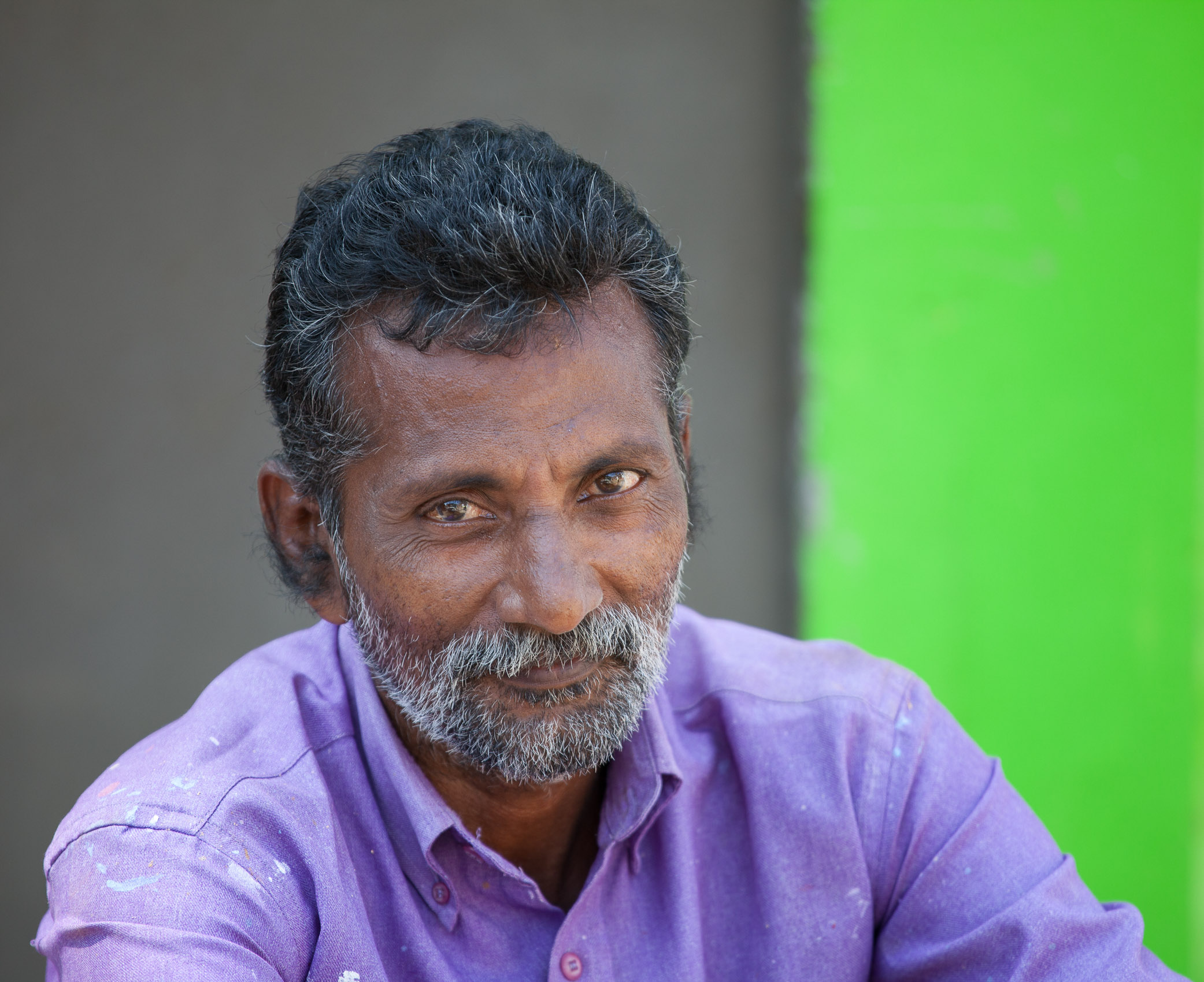India-Kerala-Cochin-Purple-Shirt-Green-Wall